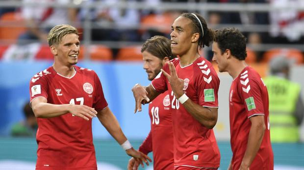 Denmark's Yussuf Yurary Poulsen, second right, celebrates with his teammates after scoring during the group C match between Peru and Denmark at the 2018 soccer World Cup in the Mordovia Arena in Saransk, Russia, Saturday, June 16, 2018. (AP Photo/Martin Meissner)