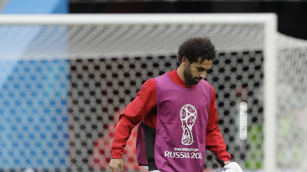 Mohamed Salah has been sidelined by a shoulder problem (AP)