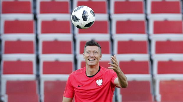 Robert Lewandowski is the big threat for Poland (Hassan Ammar/AP)