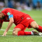 Harry Kane picks himself up after another robust challenge (Adam Davy/PA)