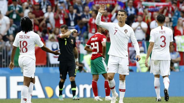 Portugal's Cristiano Ronaldo celebrates after the win over Morocco (Antonio Calanni/AP)
