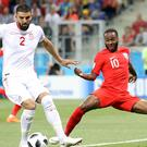 Raheem Sterling, right, in action for England against Tunisia (Owen Humphreys/PA)