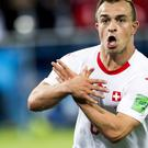 Xherdan Shaqiri celebrates his late winner (AP)