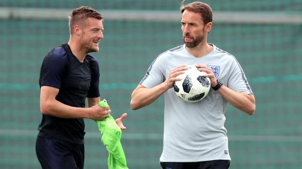 Jamie Vardy, left, was not used by Gareth Southgate, right, in the opener (Owen Humphreys/PA)