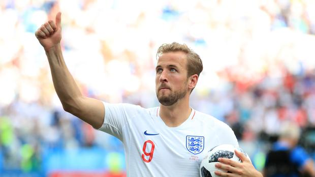 Harry Kane proudly holds his hat-trick ball (Adam Davy/PA)