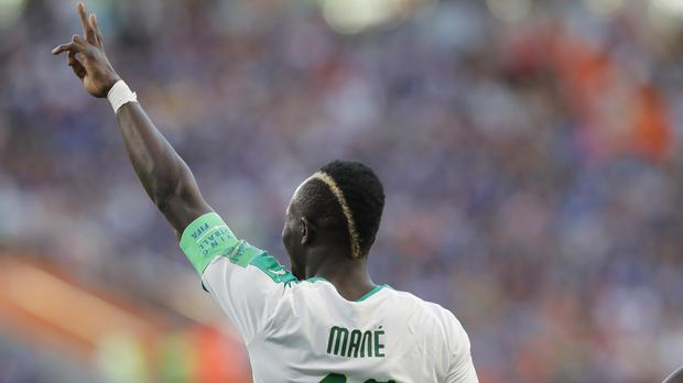 Senegal's Sadio Mane celebrates his side's opening goal (Vadim Ghirda/AP)