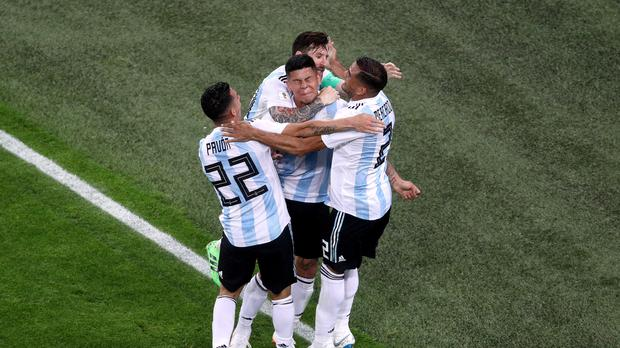 Marcos Rojo is mobbed after his winner (Owen Humphreys/PA)