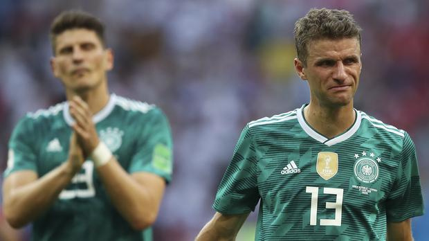 Thomas Muller, right, and Mario Gomez react after Germany's defeat (AP)
