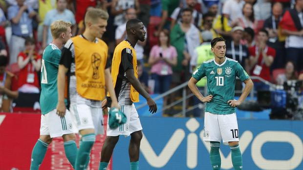 Arsenal midfielder Mesut Ozil (right) will not be staying on for the knockout stage of the World Cup. (Frank Augstein/AP Photo)