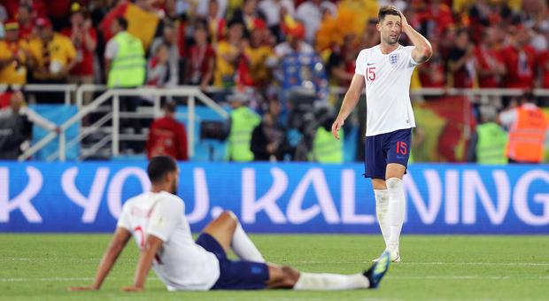 Gary Cahill, pictured right, maintains the Belgium defeat will not derail England's World Cup hopes (Owen Humphreys/PA)