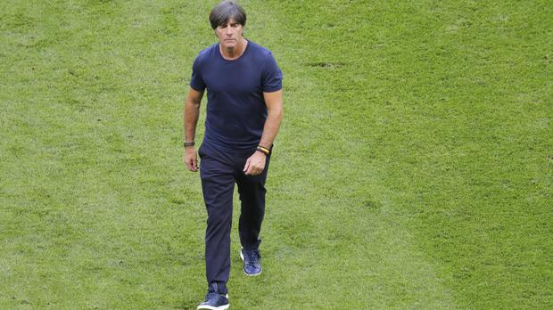 Joachim Low saw his world champions knocked out at the group stage in Russia (Sergei Grits/AP)