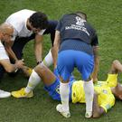 Neymar receives medical care during Brazil's World Cup victory against Mexico (Sergei Grits/AP)