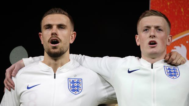 Jordan Henderson, left, says he is forever in the debt of Jordan Pickford (Nick Potts/PA)