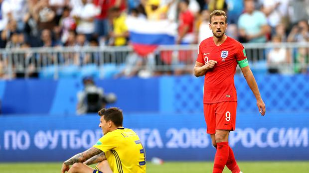 England's Harry Kane, right, is buzzing after beating Sweden (Tim Goode/PA)