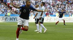 Mbappe celebrates after scoring his first against Argentina (AP)