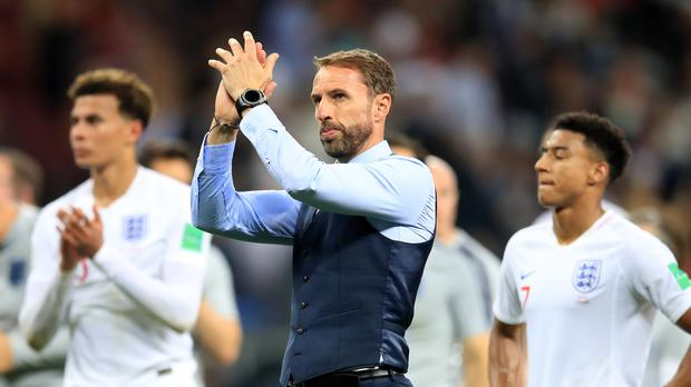 Gareth Southgate applauds the fans following England's defeat (Adam Davy/PA)
