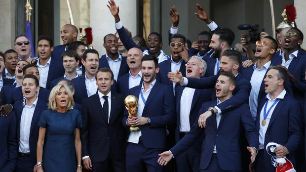 The France team celebrated with President Macron (Francois Mori/AP)