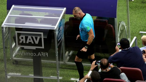 Referee Nestor Pitana checks the VAR system during the World Cup final at the Luzhniki Stadium (Aaron Chown/PA)