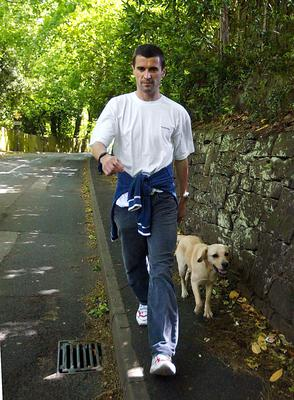 Roy Keane with his dog Triggs after leaving Ireland's World Cup squad in 2002 (Martin Rickett/PA)