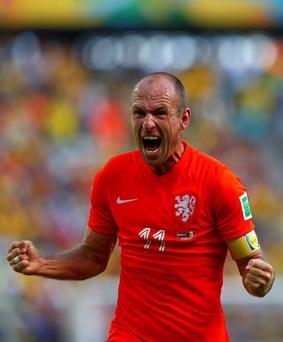 Arjen Robben of the Netherlands celebrates after winning their 2014 World Cup round of 16 game against Mexico