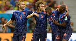 Netherlands' Daley Blind, second left, celebrates after scoring his side's second goal