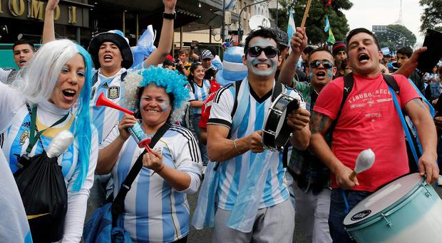Argentina's fans wait for the start of the 2014 World Cup final soccer match in Brazil between Germany and Argentina, at a public square viewing area in Buenos Aires
