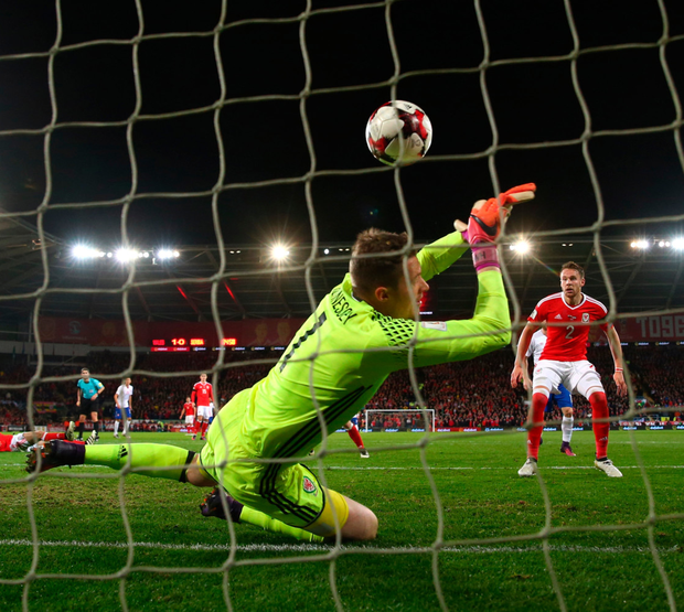Wayne Hennessey of Wales is unable to stop Aleksandar Mitrovic of Serbia scoring a dram/Getty