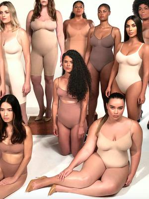 Making shapes: Kim Kardashian poses with models for her Skims campaign