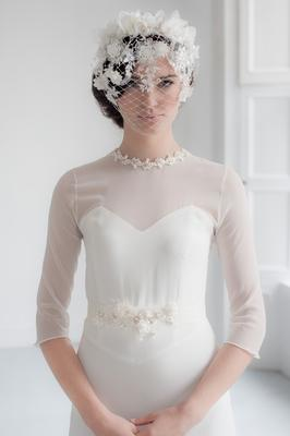 Gown, Belle & Bunty, €2,675,  Little White Dress. 'Florence' lace eye-veil with ivory petal crown, decorated with freshwater pearls and crystals, €295; lace belt embellished with freshwater pearls and crystals, €245, both Emily-Jean