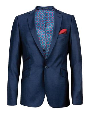 no.7 - The Solid Coloured Suit. If you wear a suit to work, or even if you don't, you should always have more than one in your fashion arsenal. A classic navy single breasted suit is the perfect place to start.