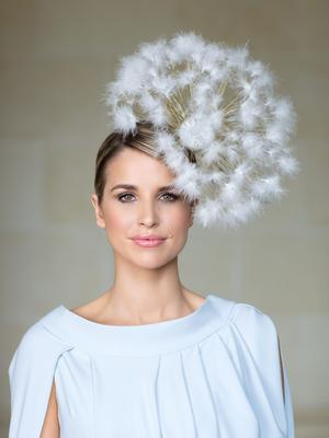 'Make a Wish' dandelion hat, €425, Mark T Burke millinery. Silver Grecian dress, €1,200 available from Umit Kutluk salon, in Arnotts, Dublin; Kalu, Naas; Luxe Room, Kilkenny and McElhinneys, Donegal. Photo: Patrick Bolger
