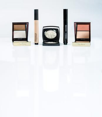 Pictured, from left, Tom Ford Shade & Illuminate in Intensity One; Smashbox Halo Highlighting Wand in Pearl; Chanel Camelia de Plume Highlighting Powder; Bobbi Brown Highlighter Pen in Opal; Tom Ford Cheek Colour Duo in Stroked. Photo: Kip Carroll.