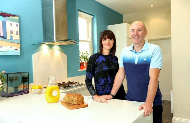 Fiona Heavey and Don Gormley in their high-gloss white kitchen, bought from Kube Kitchens. Photo: Gerry Mooney.