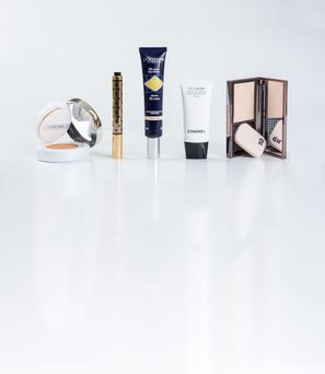 Pictured, from left, Lancome Miracle Cushion in Pure Porcelaine; YSL Touch Eclat Collector in Rose Lumiere; L'Occitane Precious BB Cream in Light; Chanel CC Cream in Beige; Urban Decay Naked Skin Ultra Definition Powder Foundation in Light Warm