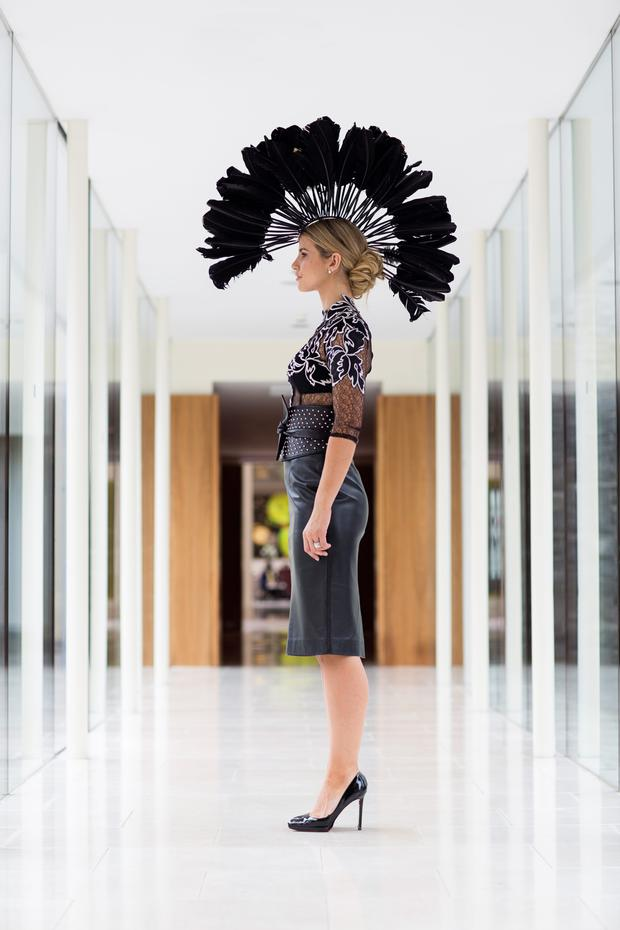 Vogue Williams wears: Turkey feather mohawk, price on request, Mark T Burke millinery. Couture lace blouse, €890, black leather skirt, €625, studded leather obi belt, €290, Umit Kutluk. 'Absolute' drop earrings, €19.95, Kilkenny Stores. Photo: Patrick Bolger