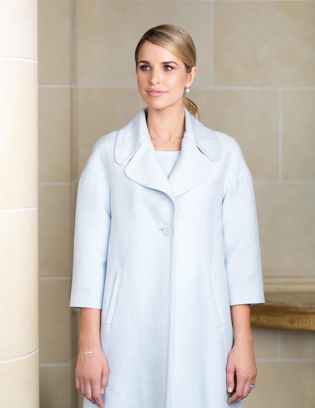Blue 'Roma' coat, €295 and 'Firenze' dress, €195, Paul Costelloe Studio at Dunnes Stores; Cluster earrings, €125, crystal set cross necklace, €130 and matching cross bracelet, €125, Paul Costelloe 'Fitzwilliam' Collection, available from Kilkenny, Nassau Street and leading jewellers. Photo: Patrick Bolger