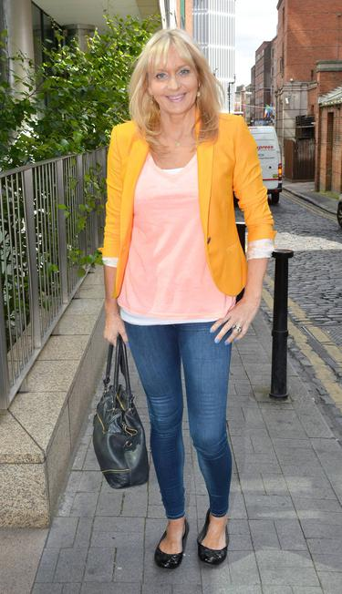 RTE star Miriam O'Callaghan glitters in gold gown at exclusive