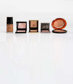 Pictured, from left, Giorgio Armani Fluid Sheer Highlighter in 14; Bobbi Brown Brightening Brick in Tawny; YSL Les Sahariennes Sun Kissed Blur Perfector in Ochre; Urban Decay Afterglow 8-Hour Blush in Video; Clarins Aquatic Treasures Summer Bronzing Compact