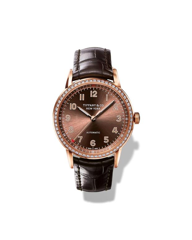 Tiffany & Co CT60 3-Hand in 18k rose-gold with round-cut brilliant diamonds, 34 mm, self-winding mechanical movement, with a brown soleil dial, on a brown alligator strap, POA. The Tiffany CT60 Collection is available from Tiffany & Co, Brown Thomas Dublin
