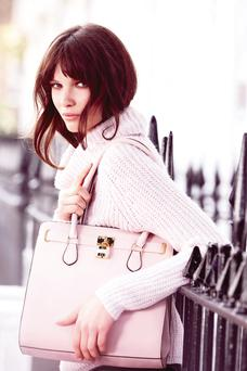Heatons: Roll neck jumper, €20, structured lock bag, €15