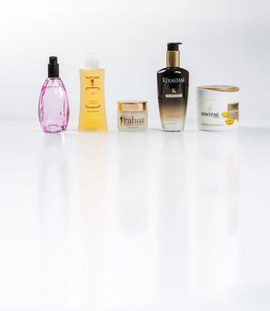 Pictured, from left, Redken Diamond Oil; Precious Nature Today's Special Oil with Grape and Lavender; Rahua Finishing Treatment; Kerastase Chronologiste Perfume in Oil; Pantene Deep Repair Masque. Photo: Kip Carroll
