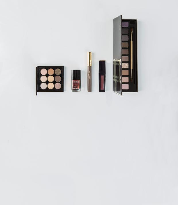 Pictured, from left, Mac Amber Times Nine Palette; Chanel Le Vernis in Troublante; Estee Lauder Magic Smoky Powder Shadow Stick in Slow Burn; Estee Lauder Pure Colour Envy Liquid Lip Potion in Bittersweet; Clarins The Essentials. Photo: Kip Carroll