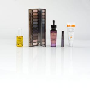 Pictured, from left, Kiehl's Daily Reviving Concentrate; Urban Decay Naked Smoky palette; YSL Forever Youth Liberator Water-in-Oil Lightweight Nourishing Oil; Urban Decay Perversion travel-size mascara; Ren Wake Wonderful Night-Time Facial. Photo: Kip carroll.