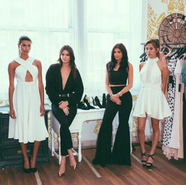 Kendall and Kylie Jenner pose with models for their new fashion line Kendall + Kylie. Instagram