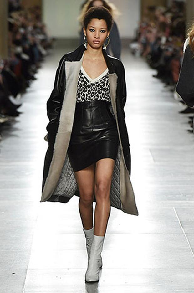 Leather combined with a shearling trim and quilted lining - this coat has everything we need. Photo: Topshop Unique AW16.