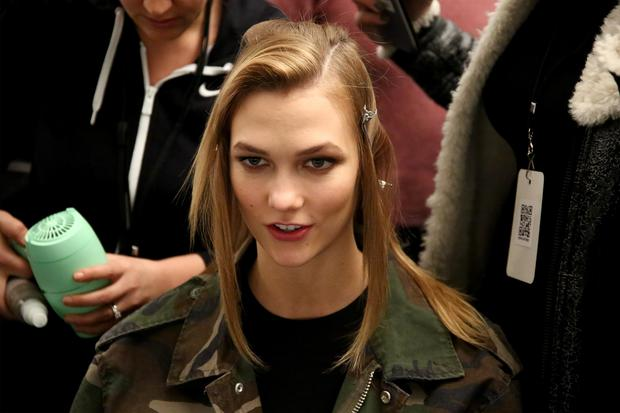 Model Karlie Kloss prepares backstage at the Jeremy Scott Fall 2016 fashion show during New York Fashion Week: The Shows at The Arc, Skylight at Moynihan Station on February 15, 2016 in New York City. (Photo by Astrid Stawiarz/Getty Images for NYFW: The Shows)