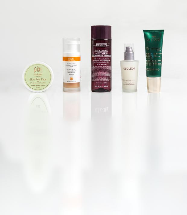 Pictured, from left, Pixi Skintreats Glow Peel Pads; Ren Glycolactic Radiance Renewal Mask; Kiehl's Iris Extract Activating Treatment Essence; Decleor Proalgene Lift Youth Concentrate; Nuxe Nuxuriance Ultra Re-Plumping Roll-On Mask. Photo: Kip Carroll