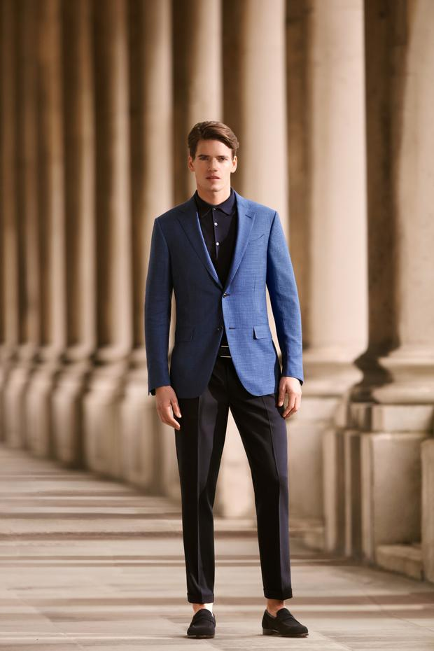 Zegna blue small check silk/linen jacket, €1,425; Paul Smith navy slim cuff trousers, €250; John Smedley polo knit, €165; Hugo Boss navy suede belt, €135; Crockett and Jones navy suede shoes, €590.