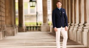 Corneliani navy textured jacket with removable inner jacket, €985; Gucci chambray shirt, €290; Canali white cotton trousers, €170; Drakes of London pocket square, €60; Crockett and Jones navy suede shoes, €590.