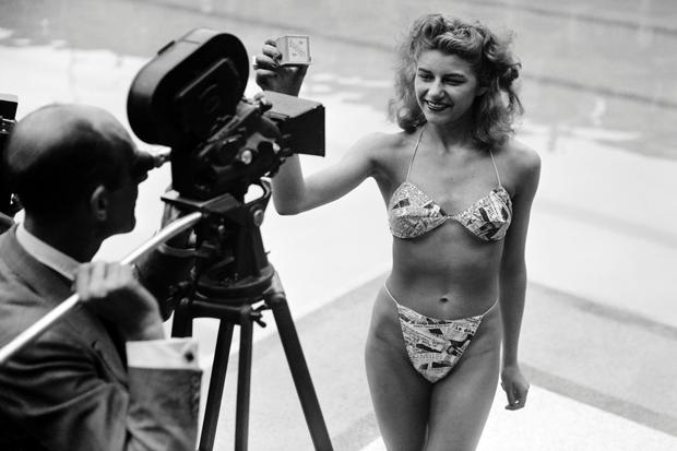 Not so haute couture: Micheline Bernardini, a 19-year-old exotic dancer, models the first bikini, designed by Louis Réard, for French press in 1946, causing worldwide controversy.